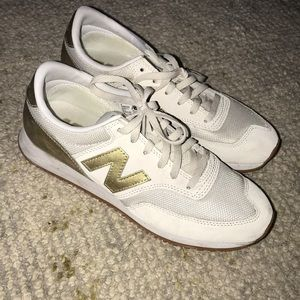 NWOT women cream and gold new balances